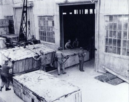 loading crates of jeeps at the dock.jpg